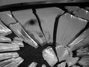 Girl reflected in a broken mirror